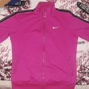 Nike track suit size large. Only worn once.